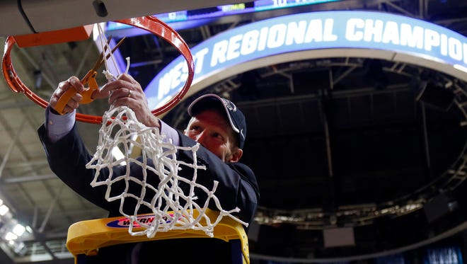 Gonzaga coach Mark Few cuts down the final strand of net after the Bulldogs defeated Xavier 83-59 Saturday in the NCAA Tournament's West Region final in San Jose. The Zags are headed to the Final Four for the first time.