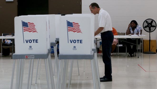People vote inside the gymnasium of the Bowens Center in Pontiac, Michigan on Tuesday, August 8, 2017 where precinct four, five and six are located.