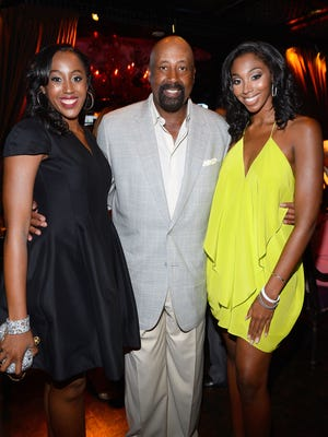Assistant coach Mike Woodson, center, of the Los Angeles Lakers and his daughters Alexis Woodson, left,  and Mariah Woodson attend the second annual Coach Woodson Las Vegas Invitational pairings party at the Lavo Restaurant & Nightclub at The Palazzo Las Vegas on July 12, 2015.