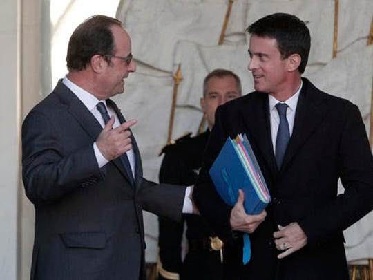 "FILE - In this Wednesday, Nov. 30, 2016 file picture French President Francois Hollande, left, speaks with Prime minister Manuel Valls after the weekly cabinet meeting at the Elysee Palace in Paris, France. French President Francois Hollande says he decided against running for another term because he wants to give his Socialist party a chance to win ""against conservatism and extremism."""