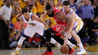 Houston Rockets guard James Harden (13) turns the ball over against the defense of Golden State Warriors guard Stephen Curry (30) and guard Klay Thompson (11) during the second half in game two of the Western Conference Finals of the NBA Playoffs at Oracle Arena.