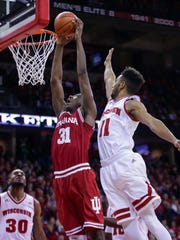 Indiana's Thomas Bryant (31) shoots past Wisconsin's