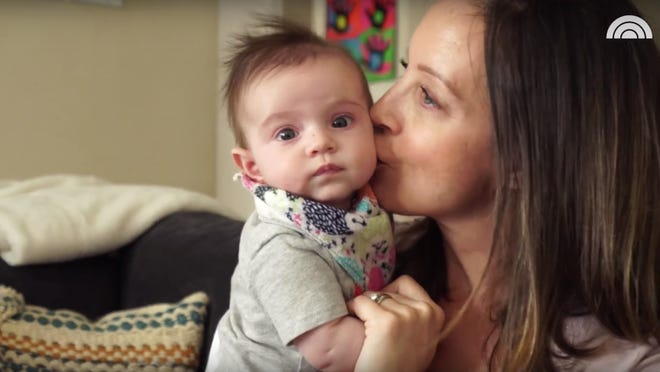Jennifer Campisano kisses her baby daughter, Noelle. Noelle is Campisano's second child.