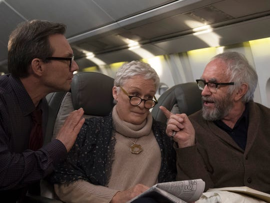 "Glenn Close (center) plays a woman caught between her famous novelist husband (Jonathan Pryce, right) and his would-be biographer (Christian Slater) in ""The Wife."""