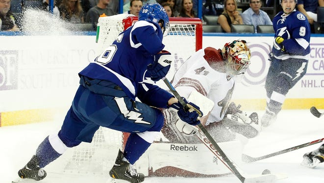 Oct 28, 2014: Coyotes goalie Mike Smith (41) makes a save against Tampa Bay Lightning right wing Nikita Kucherov (86) during the second period at Amalie Arena.