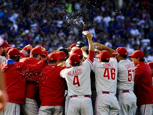 Philadelphia Phillies starting pitcher Cole Hamels gets hugged by  teammates after he threw a no-hitter against the Chicago Cubs in a baseball gamein Chicago on Saturday, July 25, 2015. The Phillies won 5-0.