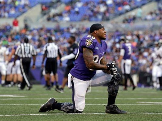 Baltimore Ravens wide receiver Steve Smith kneels during NFL football training camp, Monday, Aug. 3, 2015, in Baltimore.