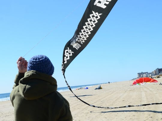 Kite flyers participate in the Kites at the Pier festival in Long Branch.