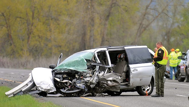 In this March 27, 2014, file photo, Oregon State Police investigate a fatal accident on Interstate 5 near Phoenix, Ore.