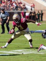 FSU freshman running back Cam Akers (3) has a monster