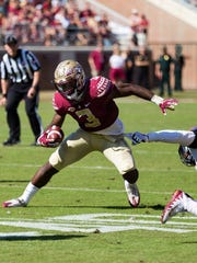 FSU freshman running back Cam Akers (3) has a monster game with 199 rushing yards and two touchdowns against Syracuse.