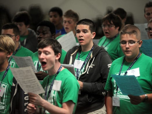 Darren Wallace of Zanesville, center, sings with the Encore Honors Choir at Hallowed Hills in Zanesville.