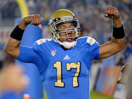 UCLA quarterback Brett Hundley celebrates after scoring