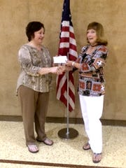 Carole Hostetter, right, of Lebanon County Chapter of PA School Retirees presents a grant to Gail Weidman a business teacher in the Annville-Cleona School District.