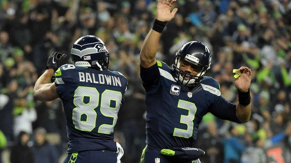 Russell Wilson celebrates after a touchdown pass Saturday.