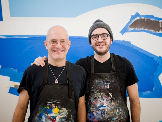 Kevin T. and Jack Kelly pose in front of one of their