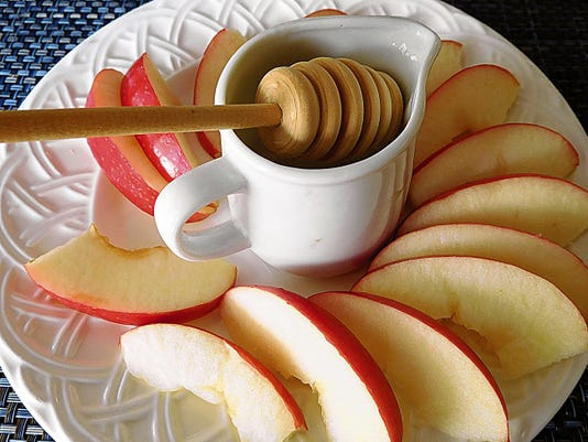 Apples and honey are a traditional at Rosh Hashanah holiday dinner. In 2015, Rosh Hashanah — the Jewish new year — starts at sundown Sunday, Sept. 13.