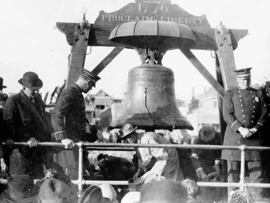Guards stand beside the Liberty Bell as work is done on its viewing platform. The bell stopped in El Paso on Nov. 16, 1915, during a national tour.