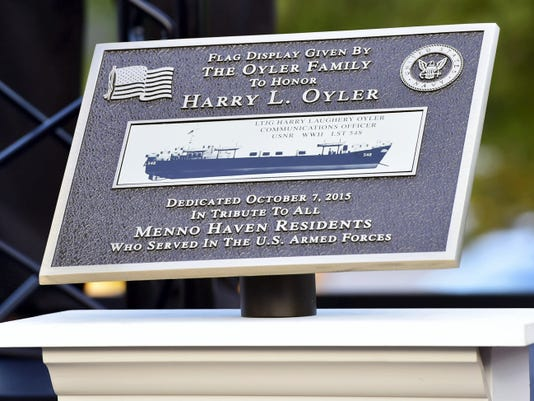 A plaque that stands beside the new Menno Haven flagpole explains that it is dedicated in honor of Navy WWII veteran Harry Oyler and is a tribute to all Menno Haven residents who served in the armed forces.