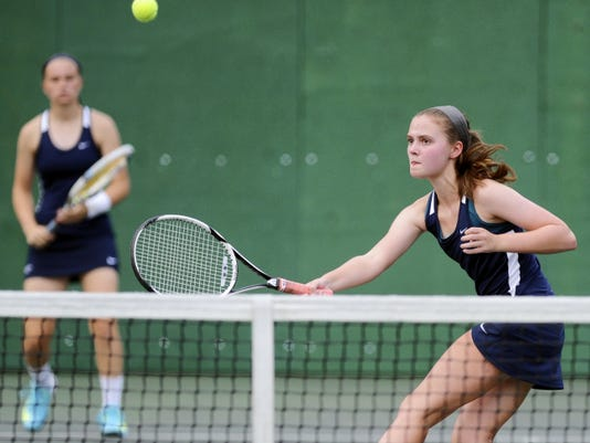 Dallastown's Morgan Kistler, right, plays at the net as teammate Madi Reed looks on during Monday's match against Lower Dauphin's Hannah Malinen and Emily Swist. Reed and Kistler earned a 6-3, 6-4 win in doubles to help the Wildcats win the match, 4-0.