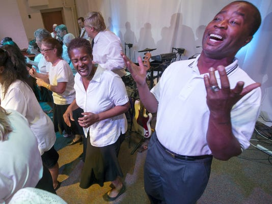 Eric Smith, right, and other members of the York County Gospel Choir perform during the Prayer for York at the Church of the Open Door. The group performs around the country.