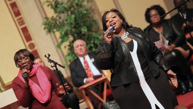 Singers at the Pentecostal Miracle Deliverance Center Church lead the congregation in a service honoring Martin Luther King, Jr. on Sunday.