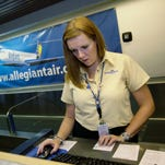 Allegiant employee Julie Bruender works at the ticket counter at Las Vegas McCarran International Airport.