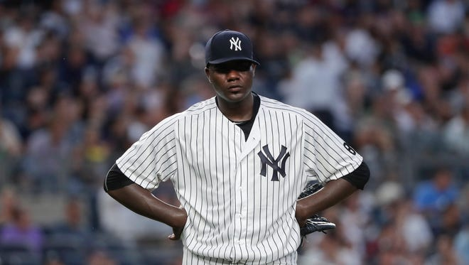 New York Yankees starting pitcher Michael Pineda reacts after giving up a two-run home run to the Boston Red Sox during the fifth inning of a baseball game, Friday, July 15, 2016, in New York.