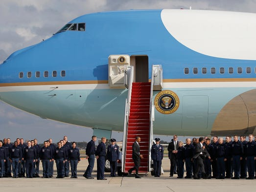 President Obama shakes hands with members of the Air