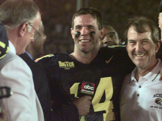 Brian Griese and Lloyd Carr at trophy presentation