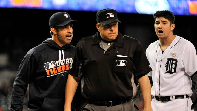 After being ejected, Tigers manager Brad Ausmus, left, has words with home plate umpire Doug Eddings in the fourth inning.