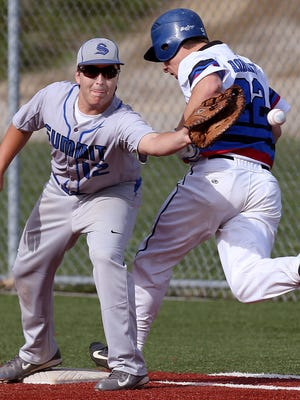 Reading's Grayson Roberts (22) hit and beat the throw to first base against Summit Country Day Connor McMurry (12) in an April 29, 2014, game.