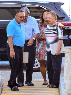 Guam Education Board members, from left, Kenneth Chargualaf, Jose Cruz, Lourdes San Nicolas and Rosie Tainatongo, prepare to enter the District Court of Guam on Friday, Nov. 18, 2016.