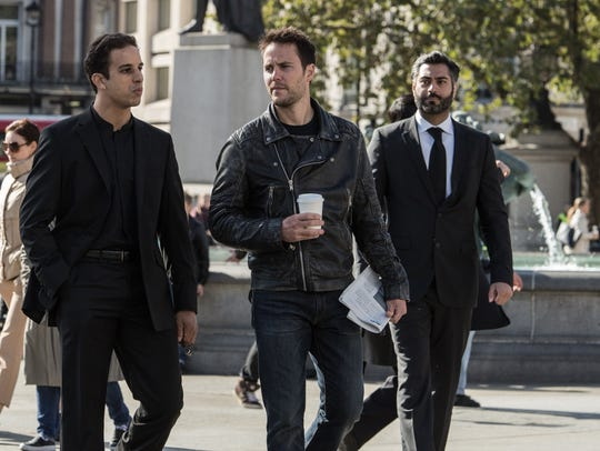 Taylor Kitsch, center, is a mysterious villain who