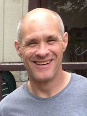 Mark Paholsky, 51, who died of cardiac arrest in 2013 soon after collapsing at the four mile mark of the 2013 Thanksgiving Day Turkey Trot 10K race in downtown Detroit. On Thursday, Nov. 27, 2014 his family will run in the race in his memory.