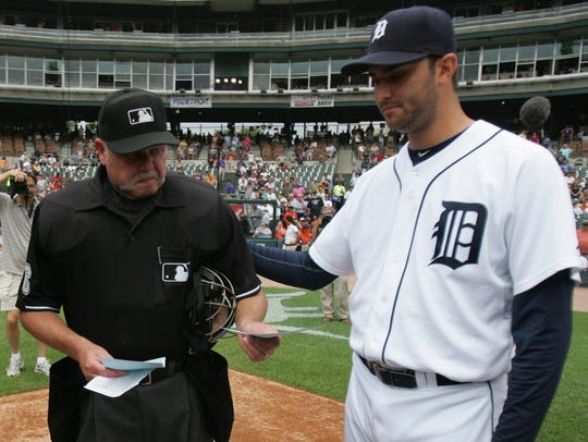Detroit Tigers pitcher Armando Galarraga, right, puts