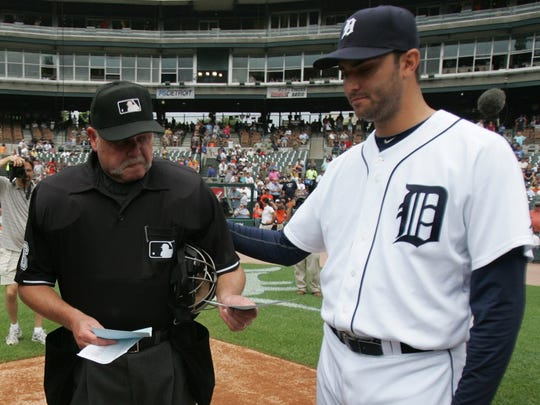 Detroit Tigers pitcher Armando Galarraga, right, puts his hand on the back of tearful umpire Jim Joyce before a game at Comerica Park in Detroit on June 4, 2010.