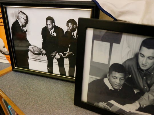 A mobile museum on Ernie Davis is circulating Elmira schools as part of Corning-Painted Post senior Brendan Walker's application for the scholarship named after the Elmira standout. Items on display include pictures of Davis learning, a replica Heisman Memorial Trophy, athletic wear and newspaper clippings.