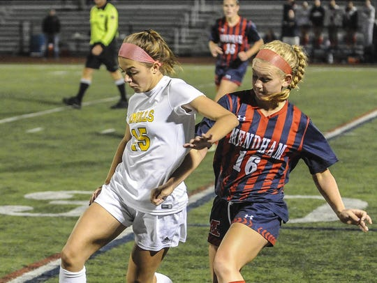 Knolls' Rebecca Racine (15) moves in front of Mendham's