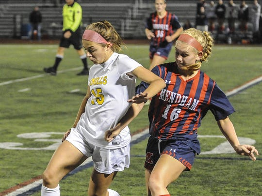 Knolls' Rebecca Racine (15) moves in front of Mendham's Maggie Cumming (16) Girls Soccer Morris County Tournament Final at Roxbury, October 21, 2017. Photo by Warren Westura for the Daily Record.