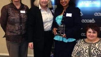 Jacqueline Archer Kenney (third from left) poses with other award winners.