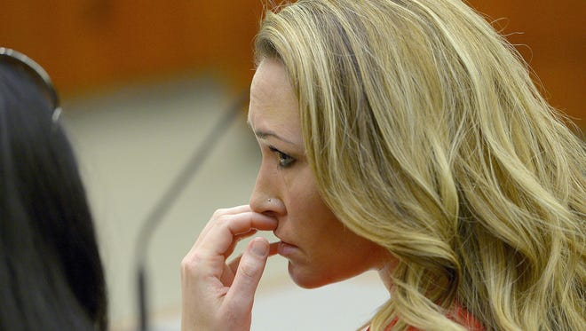 In this Jan. 15, 2015, file photo, Brianne Altice listens to the testimony during a preliminary hearing in 2nd District Court in Farmington, Utah.