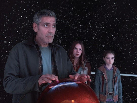 "Frank Walker (George Clooney), Casey (Britt Robertson) and Athena (Raffey Cassidy) appear in a scene from ""Tomorrowland."""