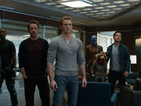 "This image released by Disney shows, from left, Jeremy Renner, Don Cheadle, Robert Downey Jr., Chris Evans, Karen Gillan, the character Rocket, voiced by Bradley Cooper, Paul Rudd and Scarlett Johansson in a scene from ""Avengers: Endgame."""