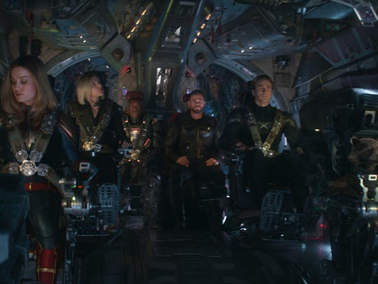 Several Avengers: Endgame characters in a spaceship