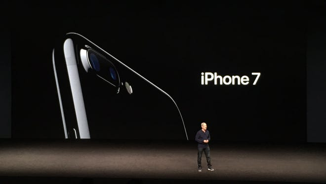 Apple CEO Tim Cook unveils the new iPhone 7 at the company's event in San Francisco Sept. 7.