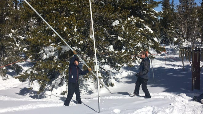 Hydrologist Jeff Anderson and district conservationist Jim Gifford of the Natural Resources Conservation Service Nevada ready a 20-foot tube used to measure snow depth in order to take a measurement of the snowpack on Slide Mountain on March 1. The pack measured 212 inches.