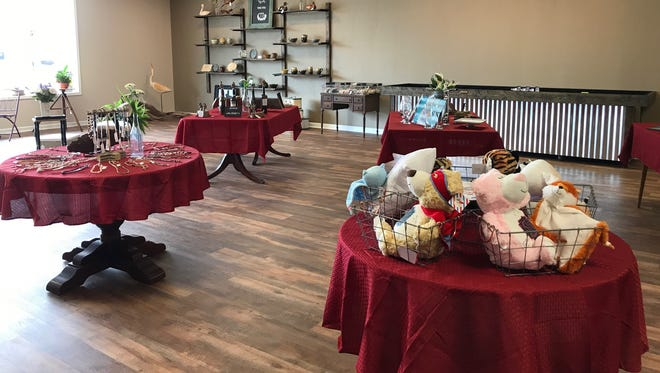 The inside of Artisans Collective is warm and filled with locally crafted items.