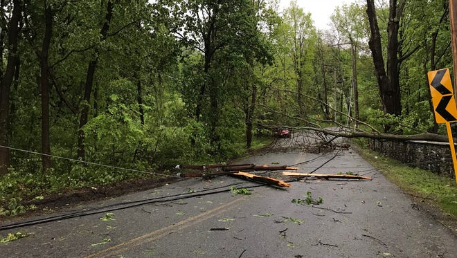 A downed tree and a utility pole block off Wheeler Hill Road in Wappingers Falls on Tuesday.