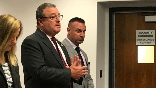 Middlesex County Assistant Prosecutor Christine D'Elia, attorney Jeffrey Ziegelheim and Officer Paul Pappas